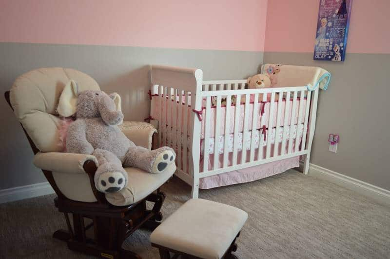 Child's room with cot and nursing chair, an ideal set up for the baby sleep training.