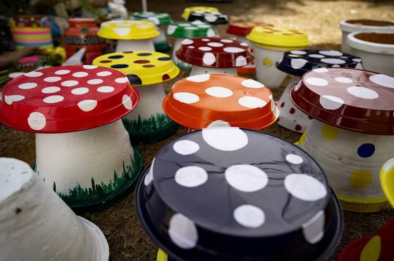 A DIY garden idea turns a dozen or more old terracotta pots into colourful mushrooms.