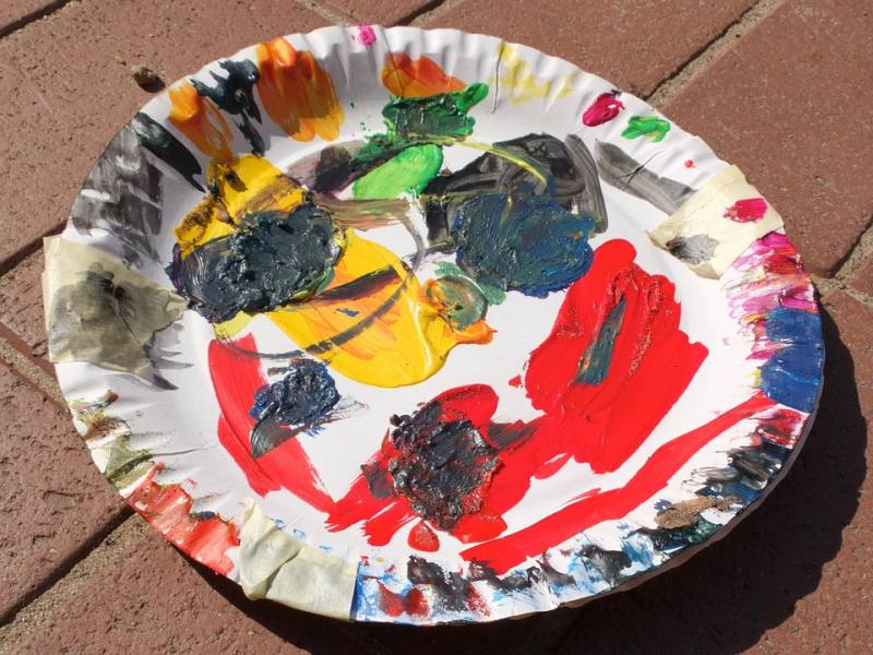 Two paper plates stuck together with masking tape to make a colour palette for painting for an easy art project.