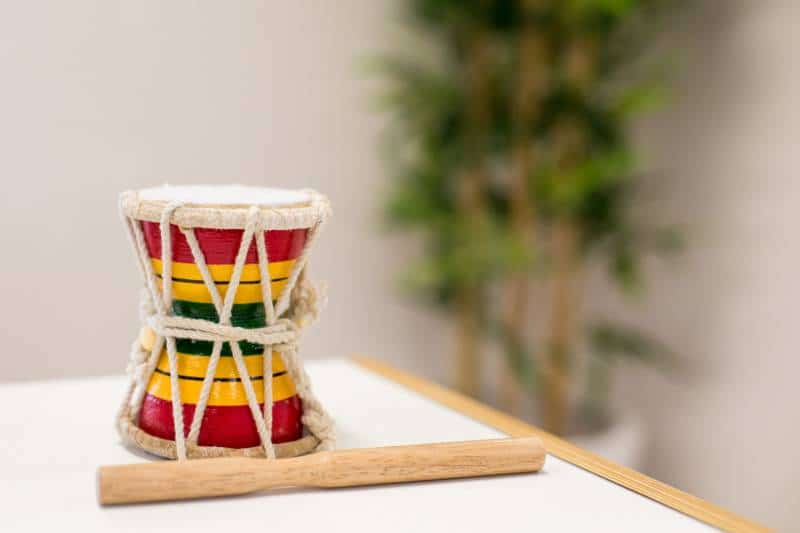 Music playing games are fun with a child's two-sided marching drum.