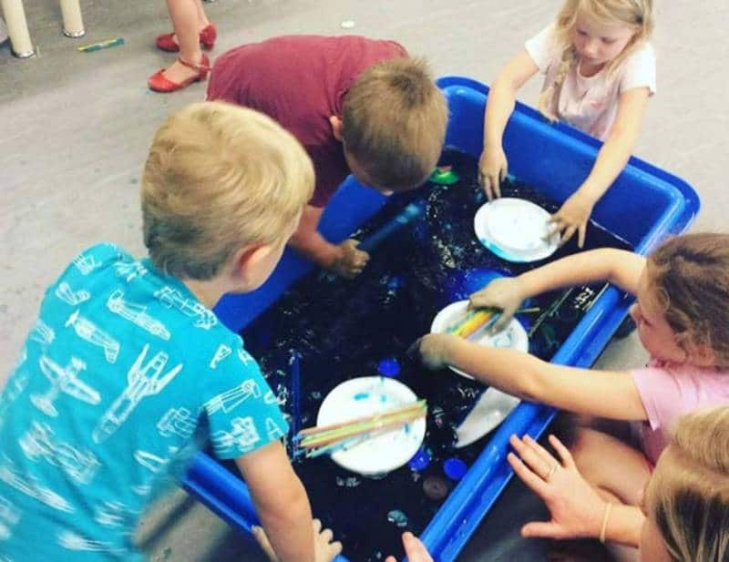 Supporting a child's learning through play with water-based play at Petit Caloundra