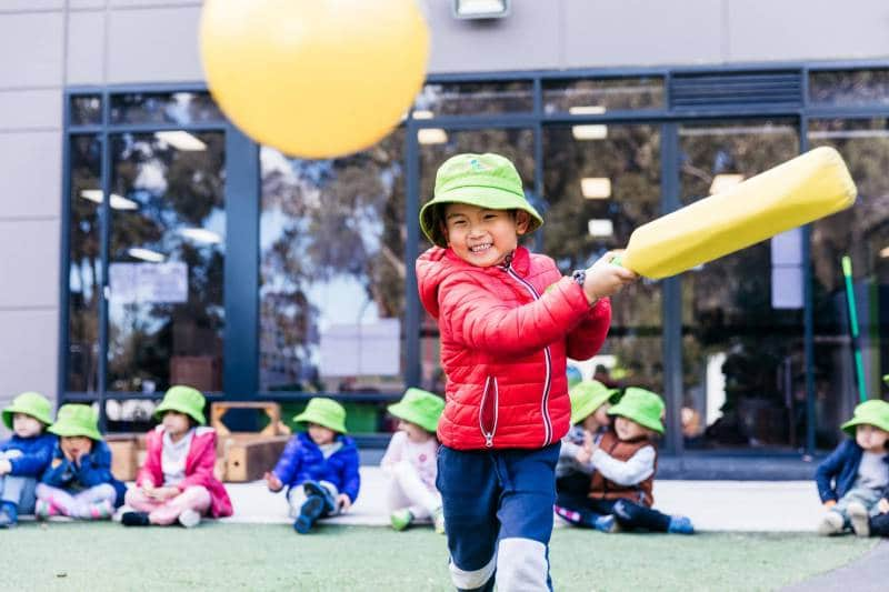 Children's fun activities involve playing with bat and ball At Petit ELJ Forest Hill.