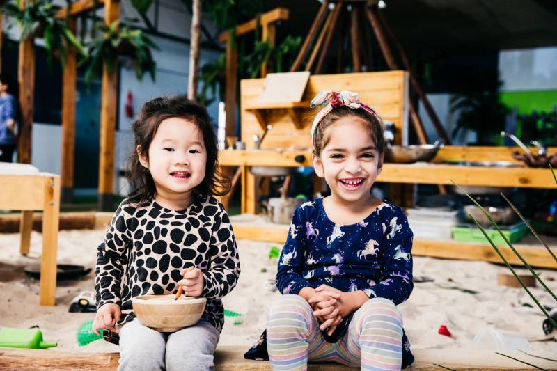 Two children from different cultural backgrounds play happily together - evidence of cultural diversity in childcare in Australia