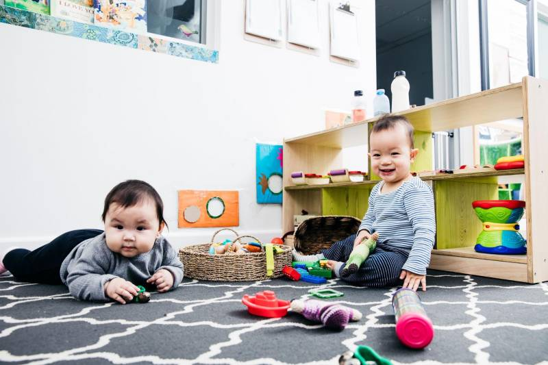 Babies play together in the nursery of a quality daycare.