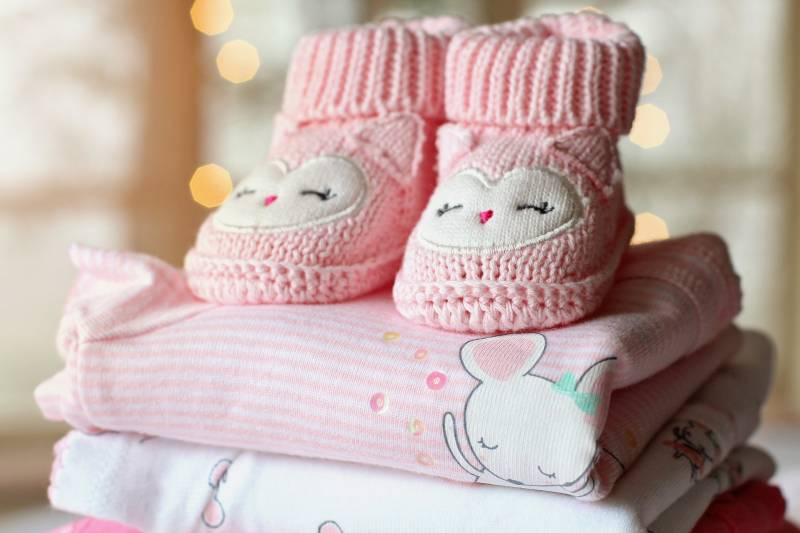 Essential baby things like newborn jumpsuits and booties.