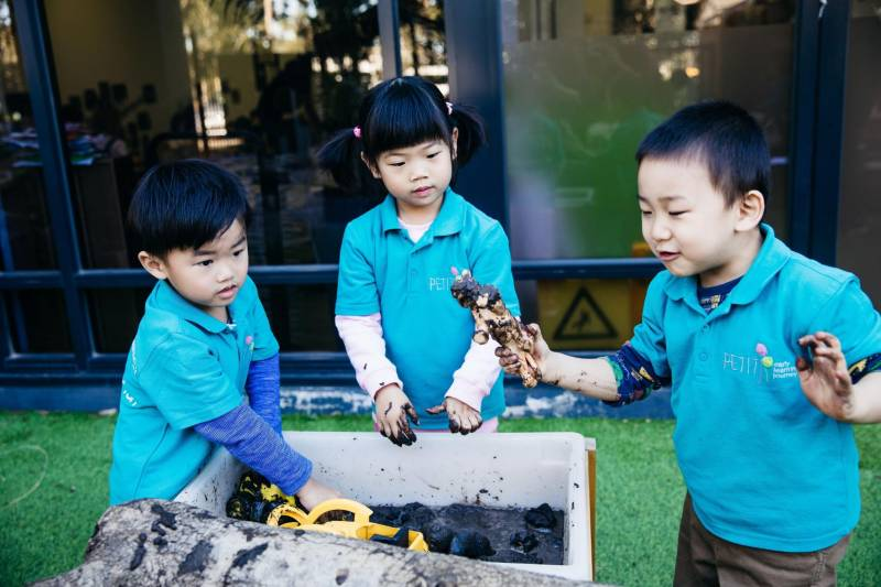 Children combine mud, toys and nature, the benefit of sensory play.