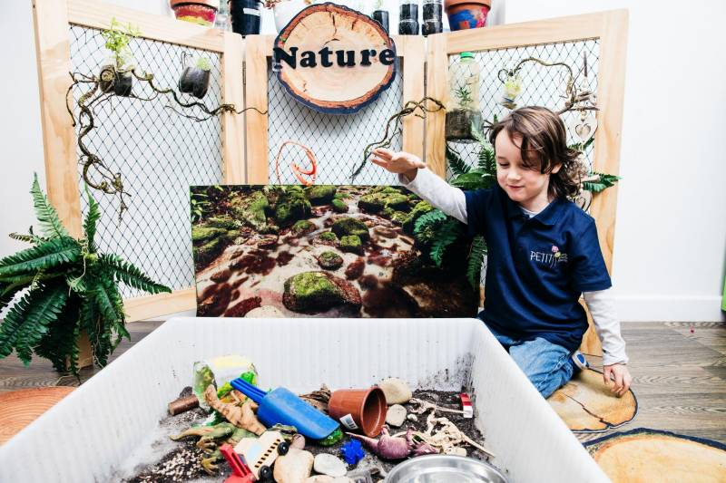 Child engages in nature sensory activities for toddlers and preschoolers.