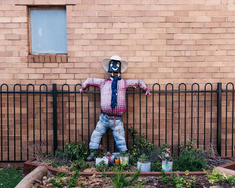 Scarecrow and flower pots make great recycling projects for children.