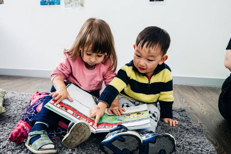 A picture book can stop toddlers from biting by showing children like these two toddlers how to express feeling words.