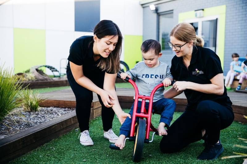 Child learns to ride a tricycle an example of a gross motor skill milestone.