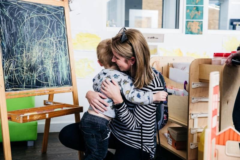 Mum hugs child. Achieving work-life balance for parents means more family time.